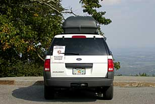 Vehicle with Blue Ridge Parkway biological survey sign used while ground truthing vegetation mapping project.