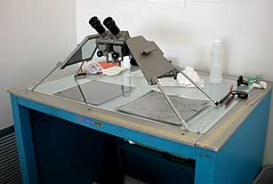 Stereoscope and light table used in attributing Blue Ridge Parkway infrared aerial photographs.
